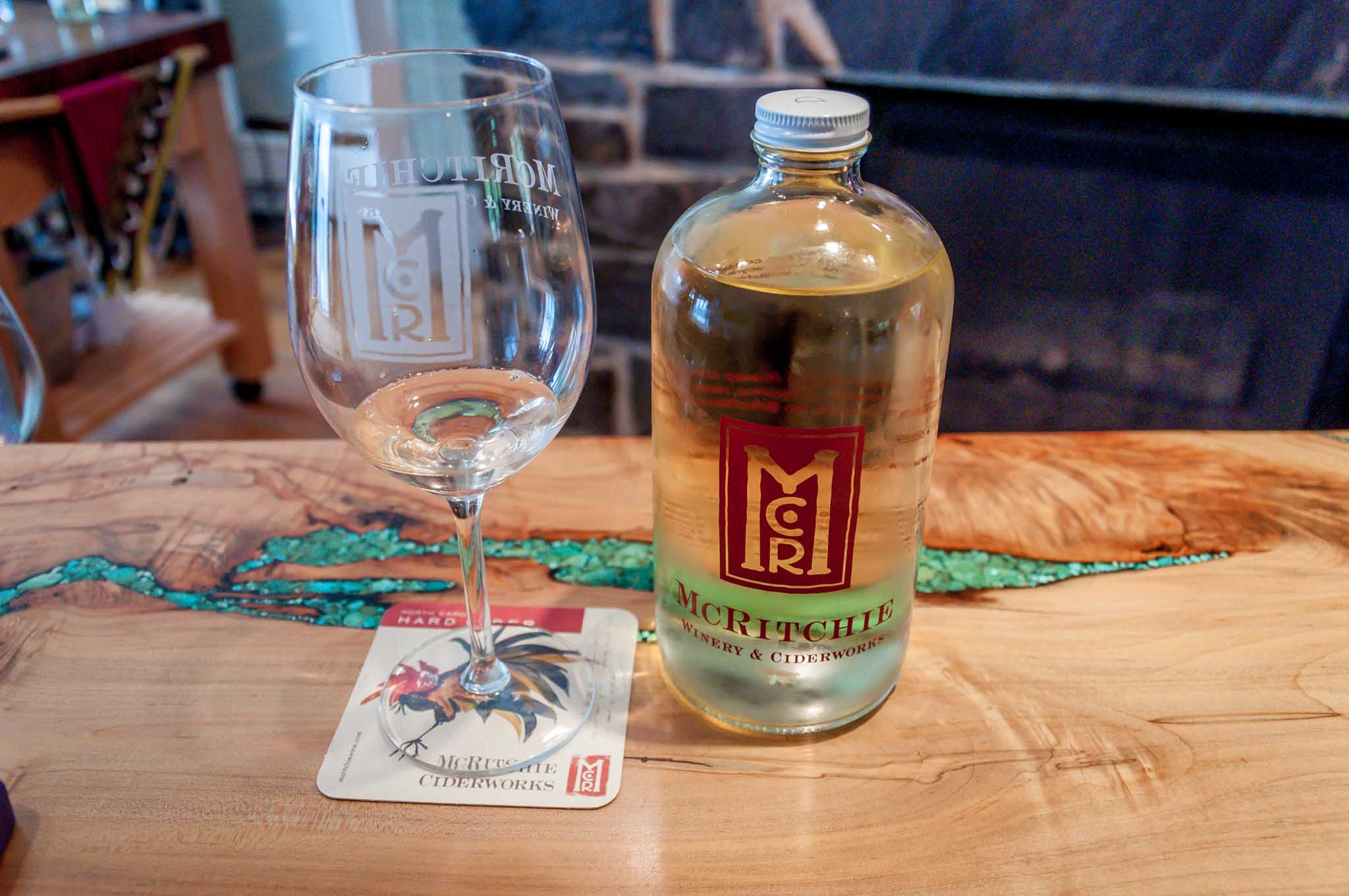 Bottle of cider and glass at McRitchie Vineyards and Ciderworks