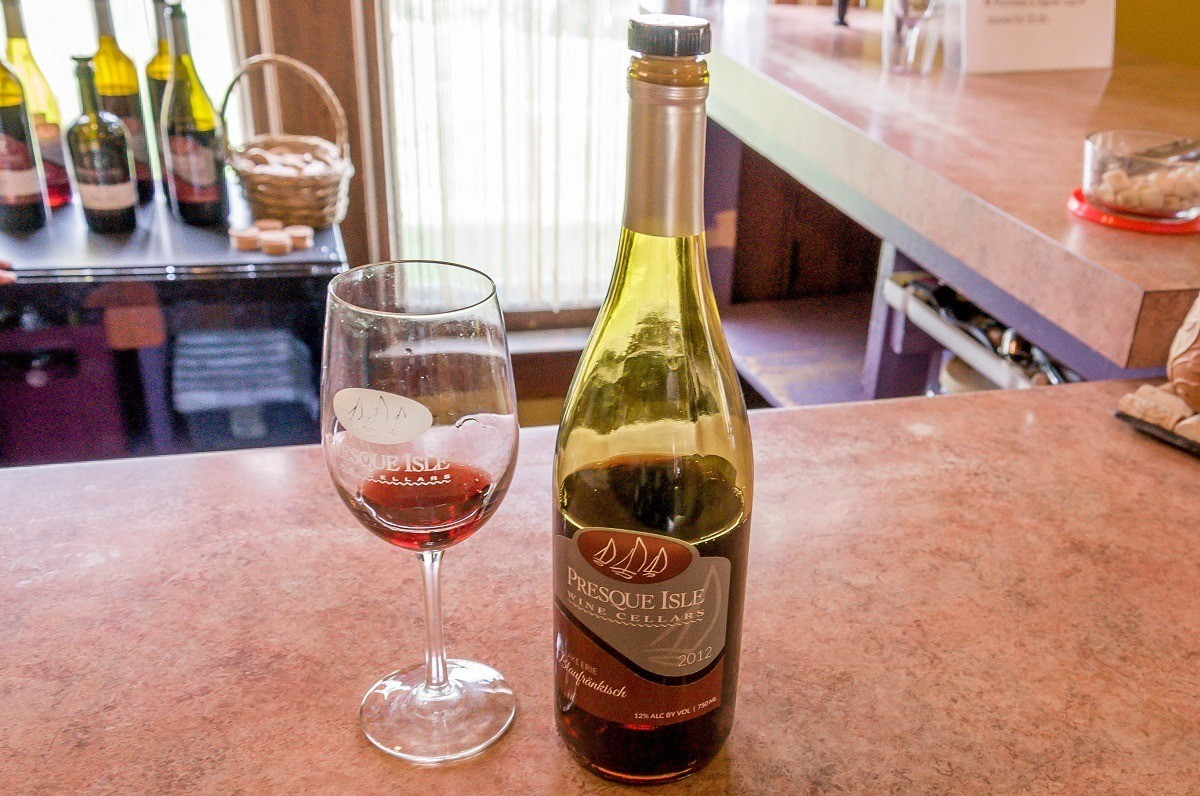 Wine bottle and glass at Presque Isle Wine Cellars