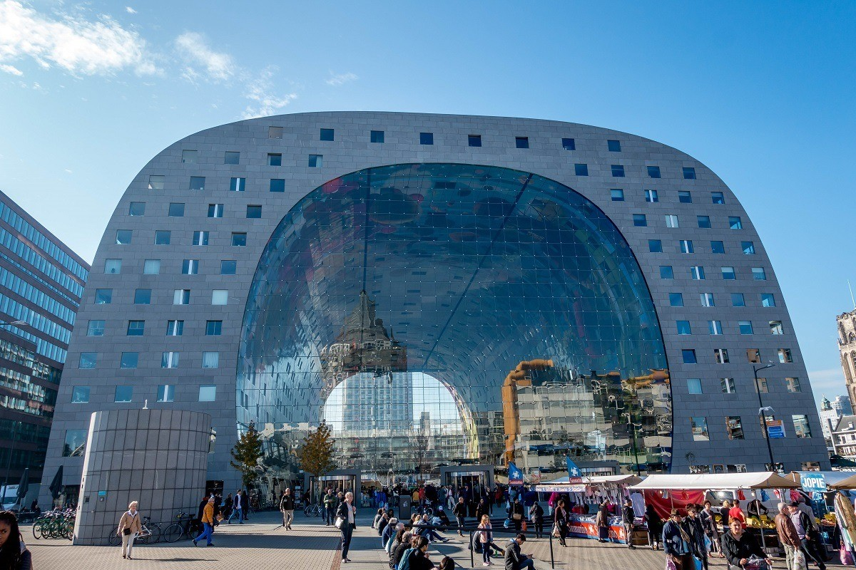 Exterior of Rotterdam's Market Hall, large arch-shaped building with glass walls