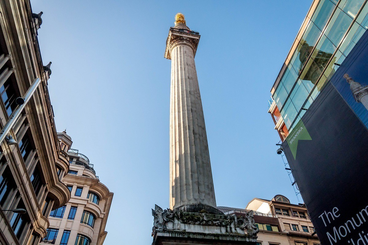 The Monument to the Great Fire, one of the first stops on our London Walking Tour