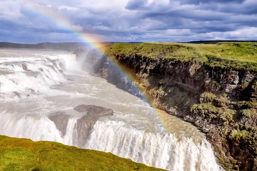 Rainbow over a large waterfall