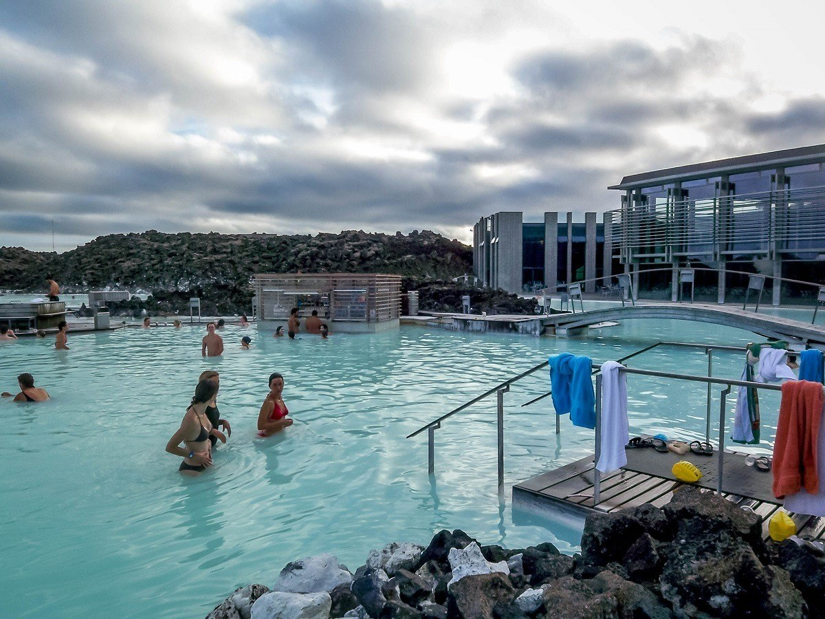 Bathers taking a dip in the Blue Lagoon thermal pool, one of the top Iceland attractions