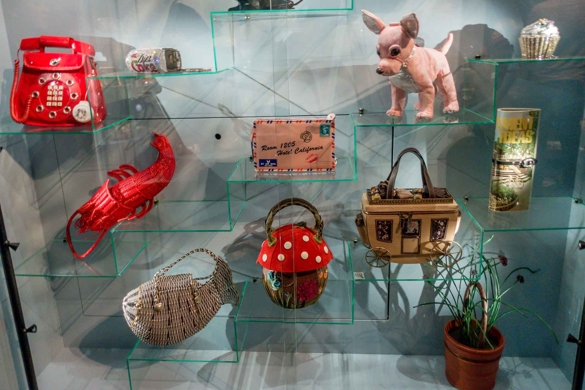 Purses shaped like dogs, lobsters, telephones, and other items
