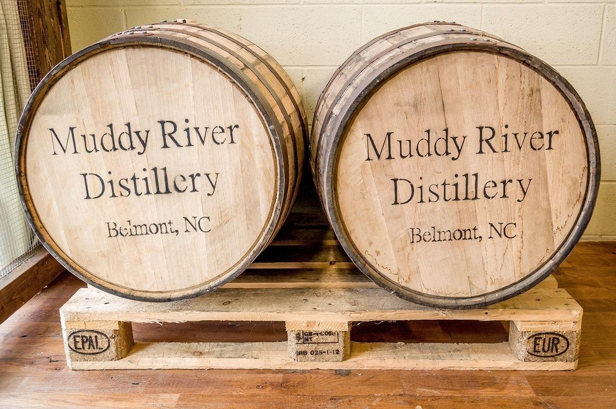 Rum aging in barrels at Muddy River Distillery