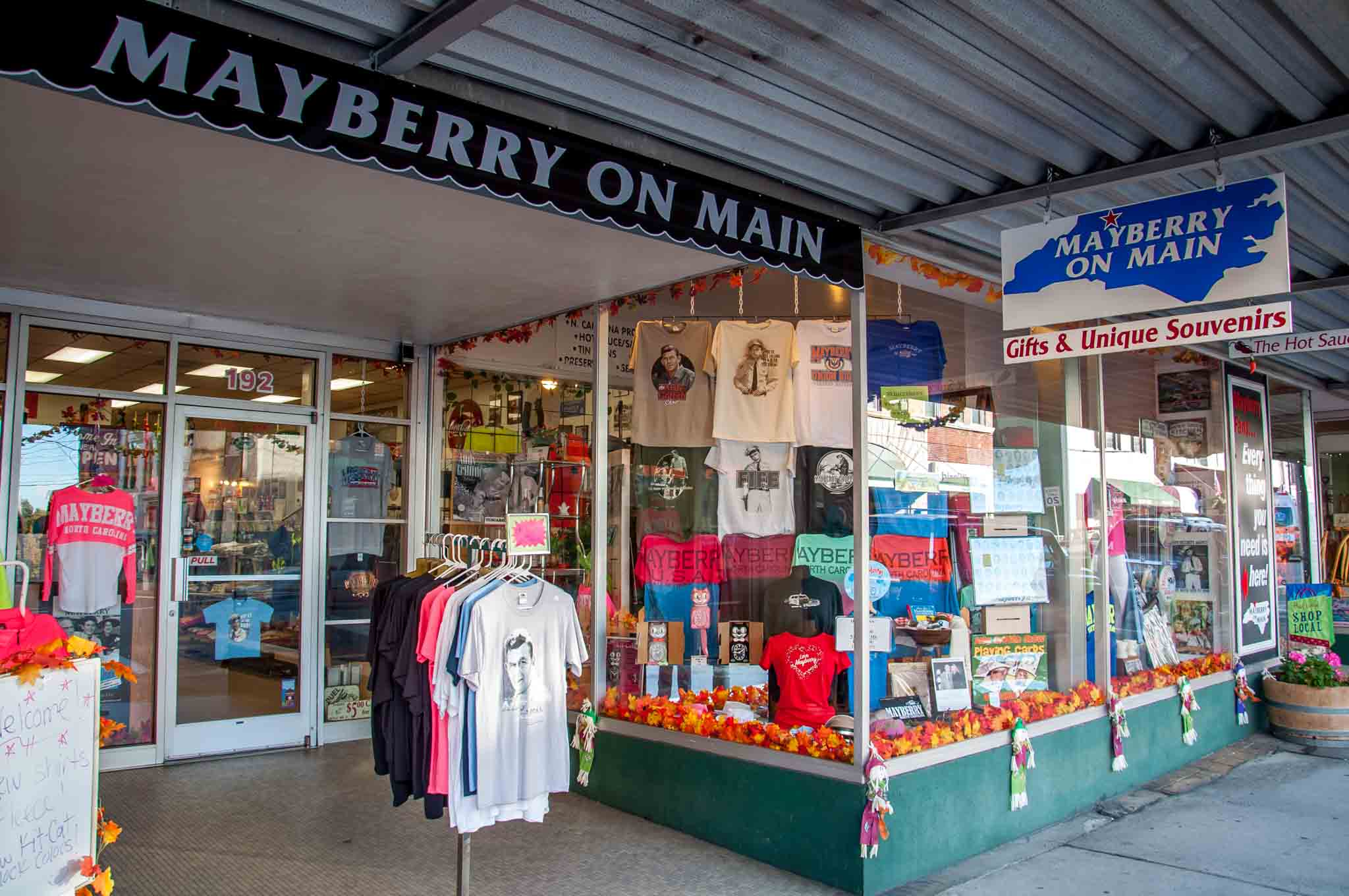 T-shirts in storefront of Mayberry on Main, a souvenir shop