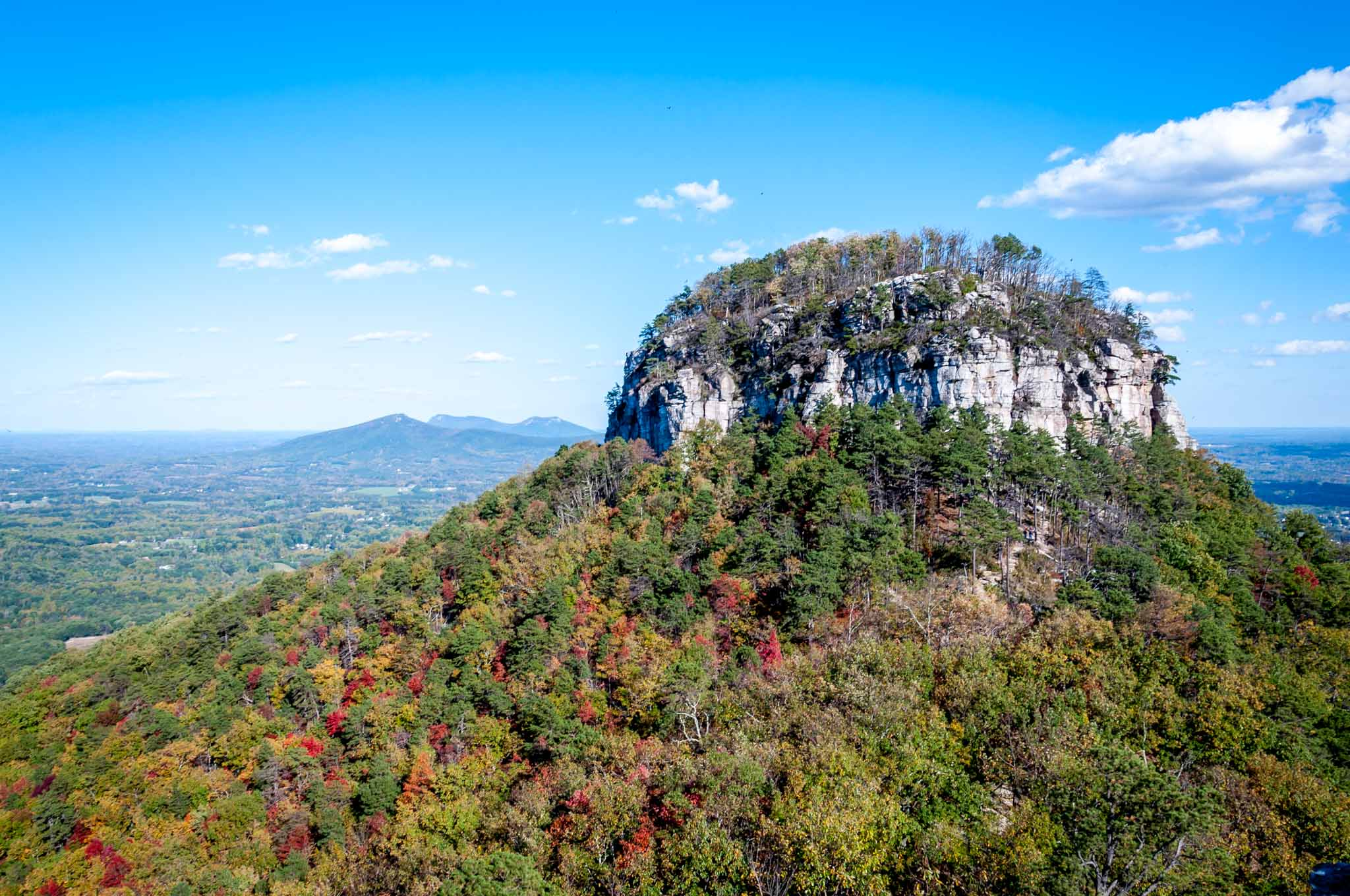 Mountain covered in fall foliage at Pilot Mountain State Park