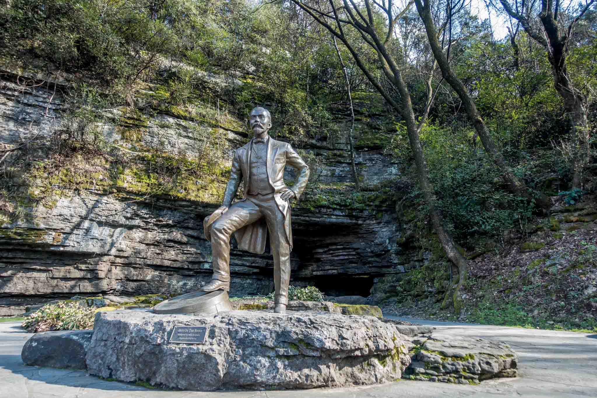 Statue of Jack Daniel in front of a cave spring