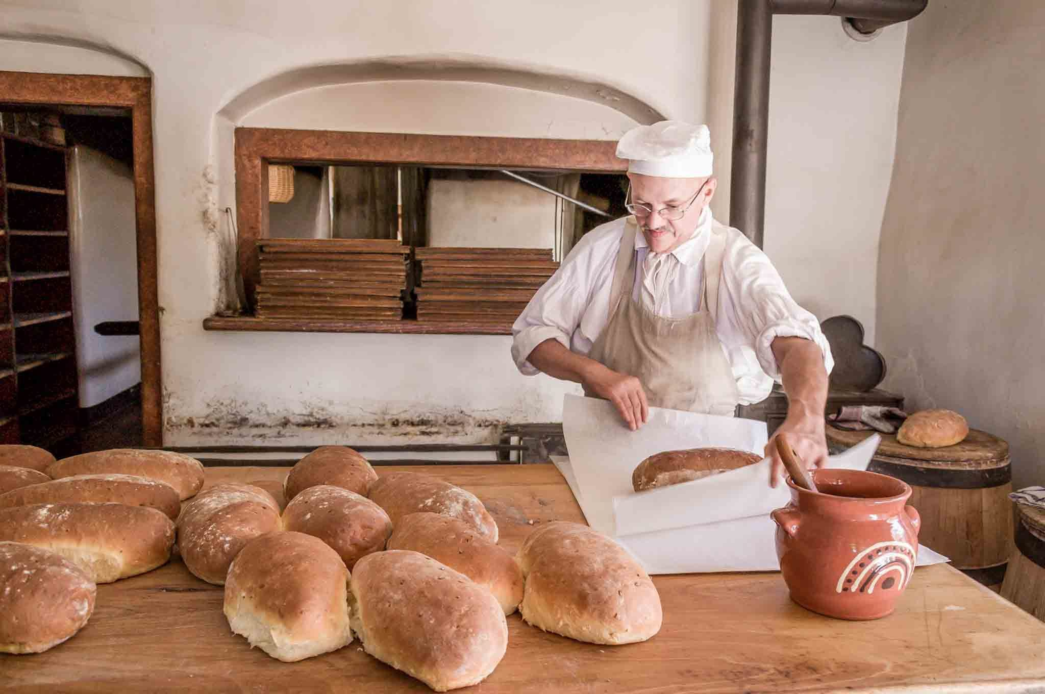 Baker making onion bread loaves