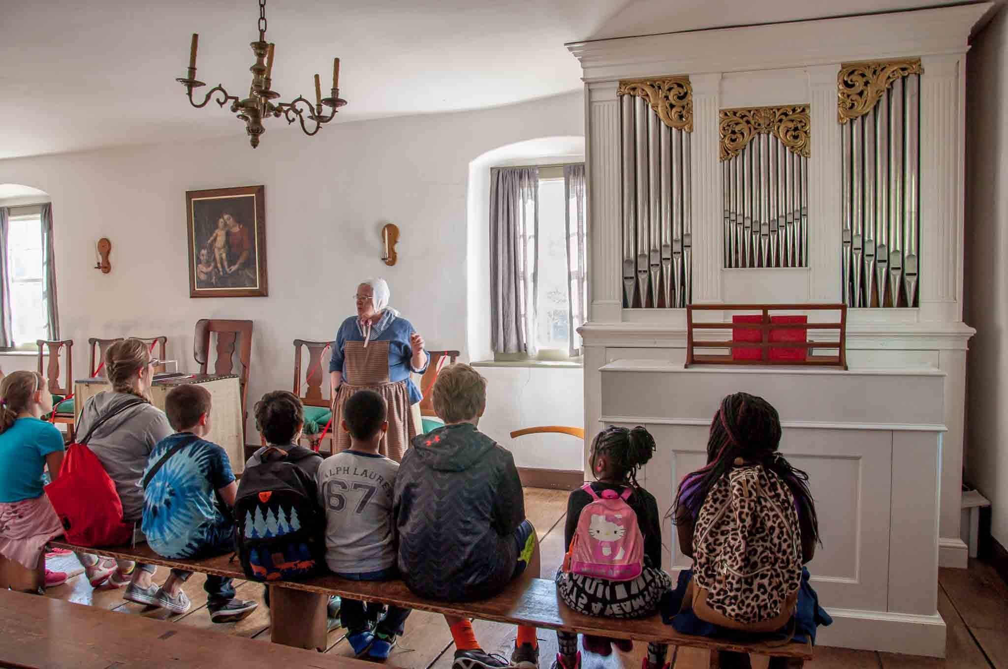 Group of children listening to a lecture in the chapel