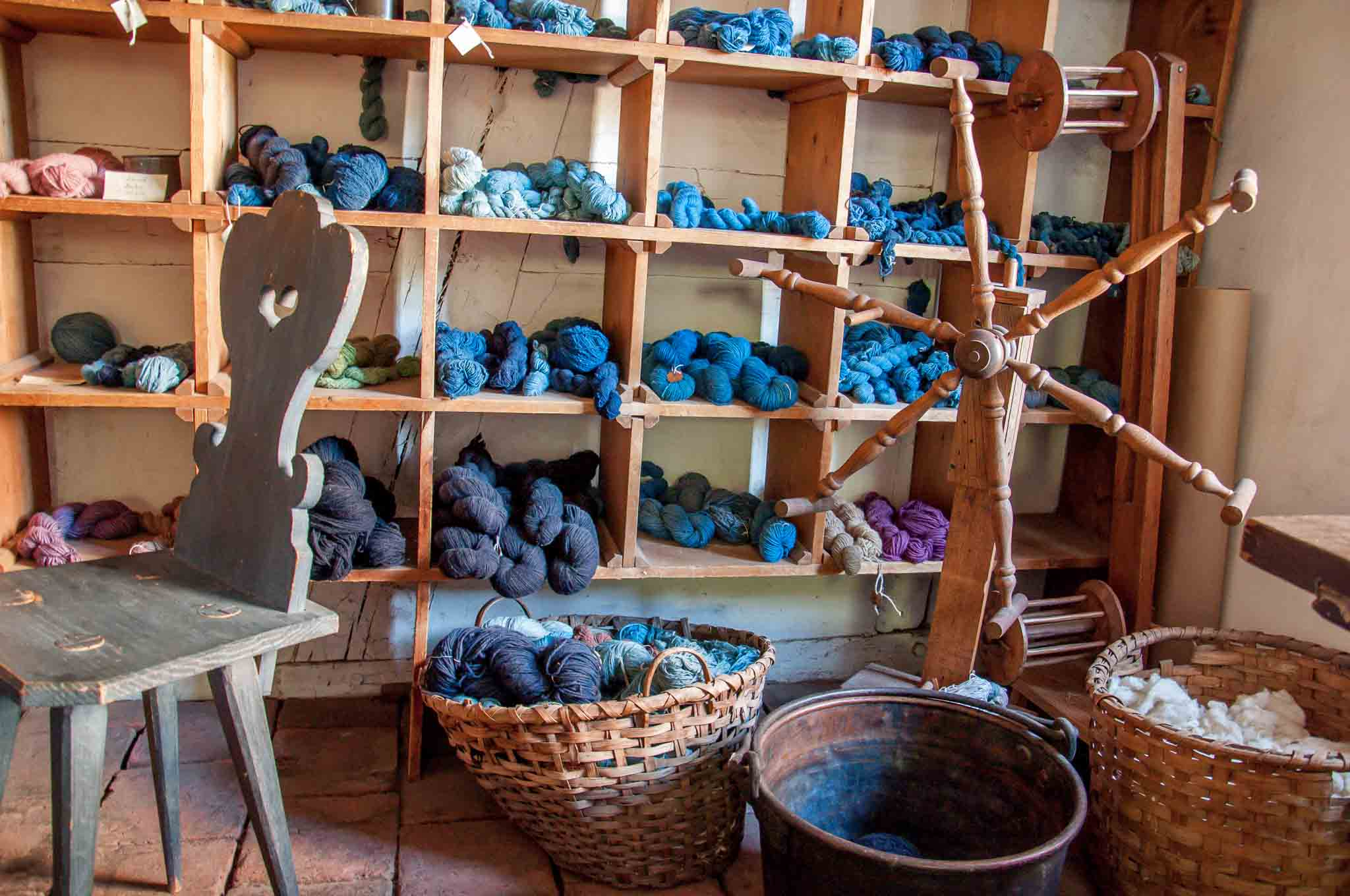 Colorful yarn skeins and spinning wheel