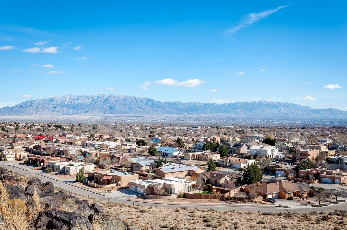 Houses of suburban Albuquerque with mountain in the distance