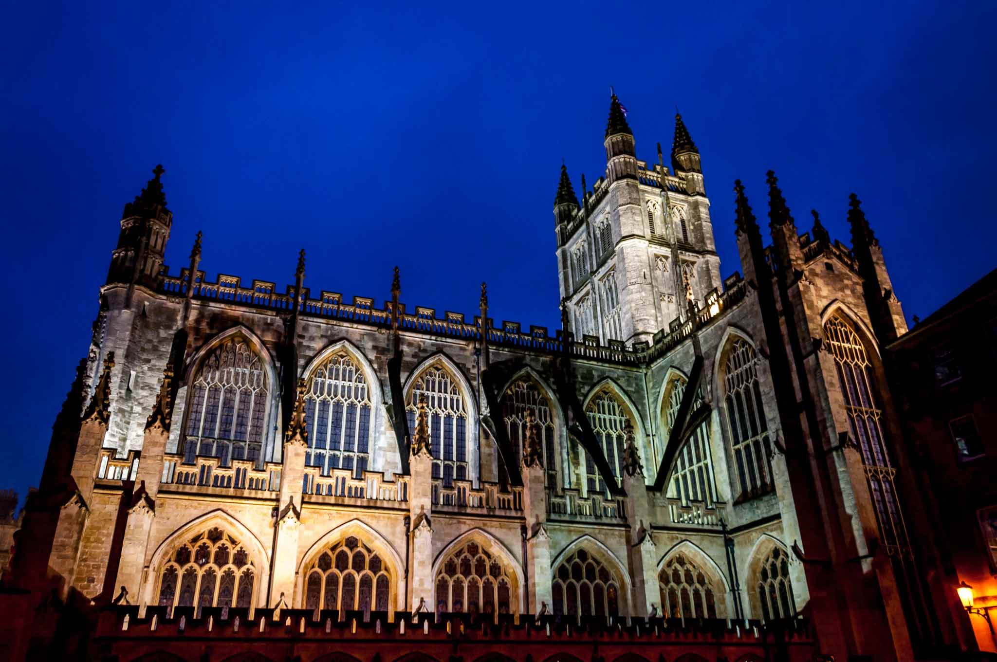 Gothic cathedral lit in colorful lights at night, the Bath Abbey