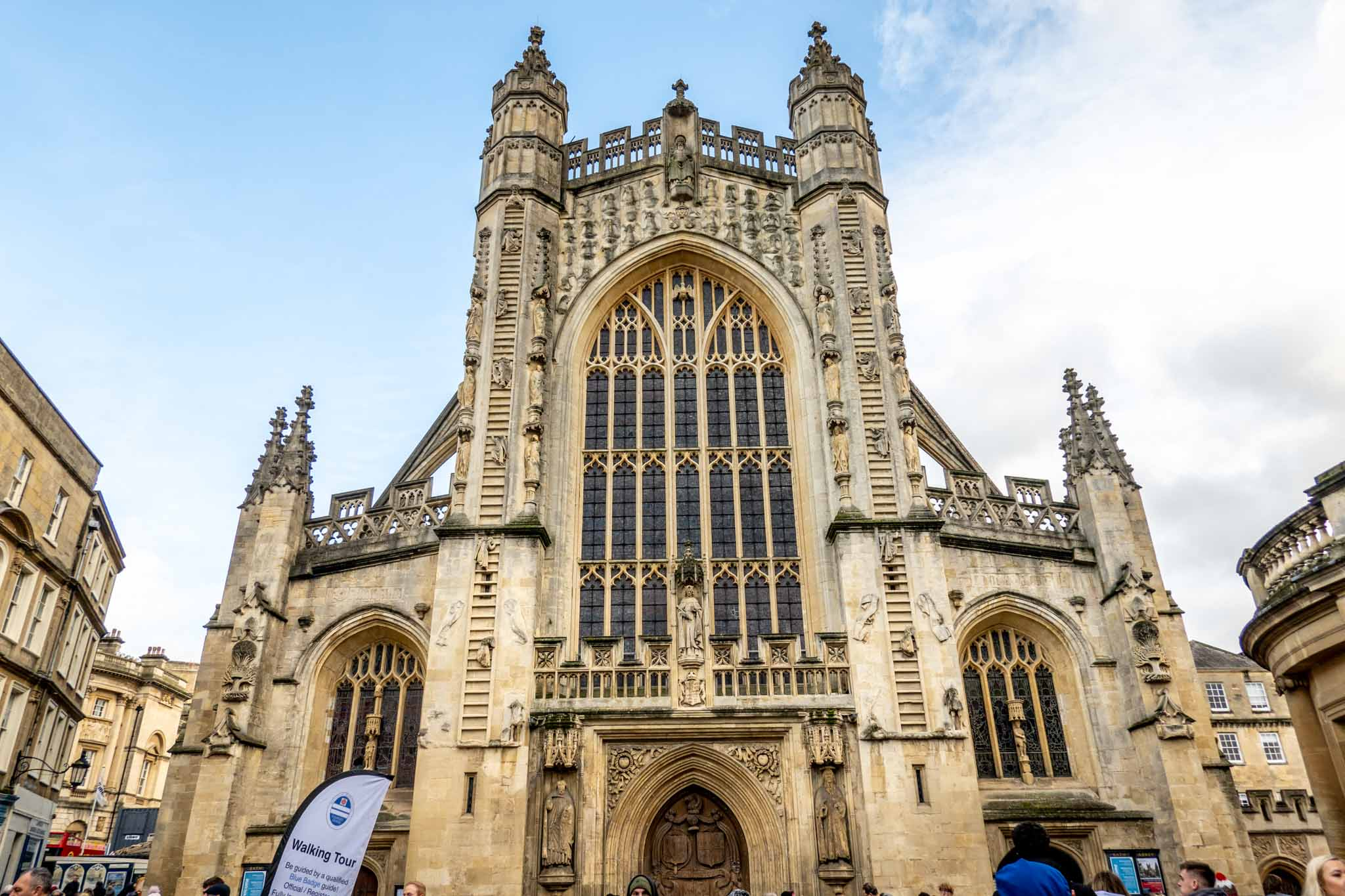 Outside of Bath Abbey showing its stained glass windows and arches