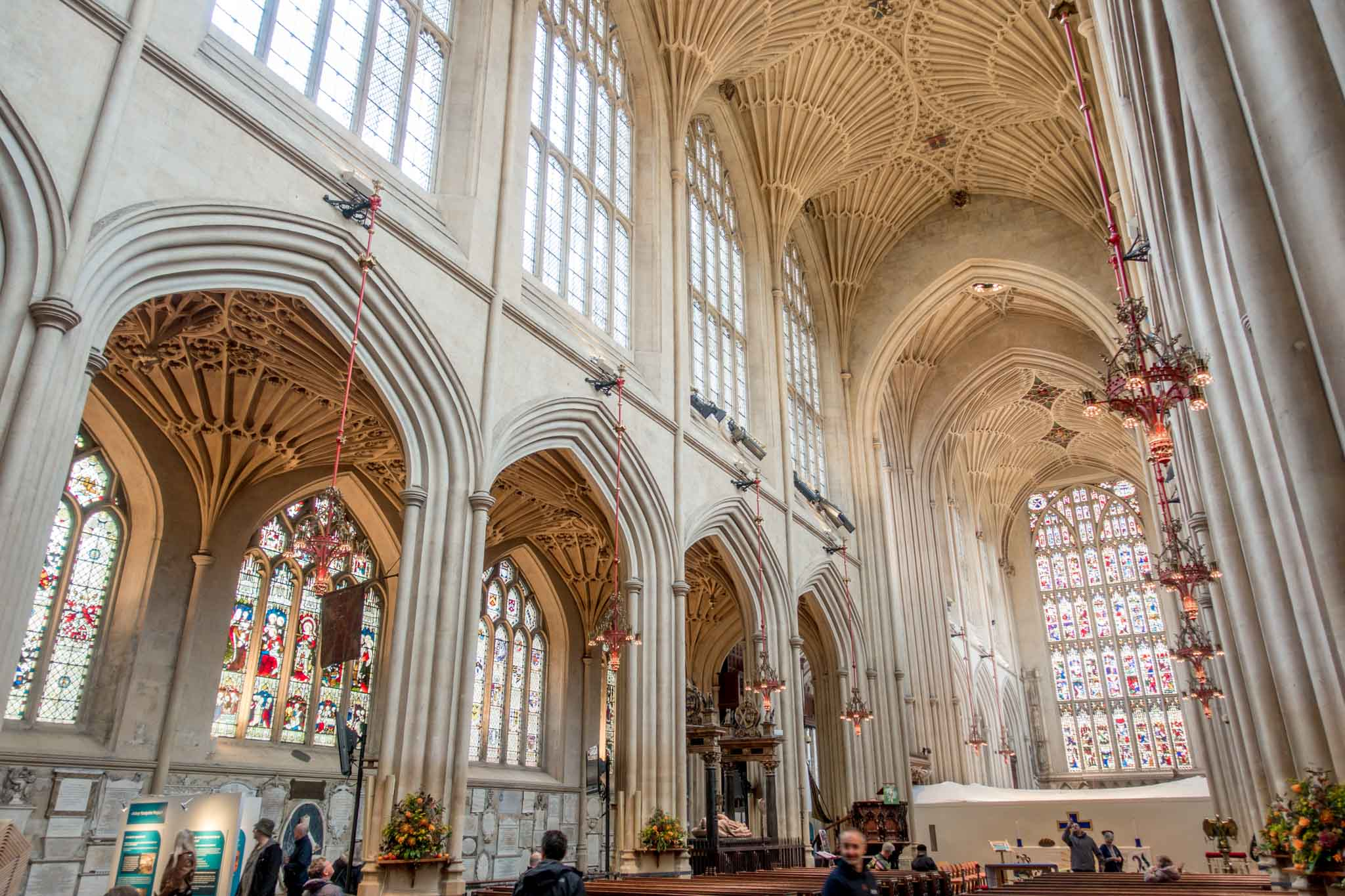Stained glass windows and vaulted ceilings inside Bath Abbey in England