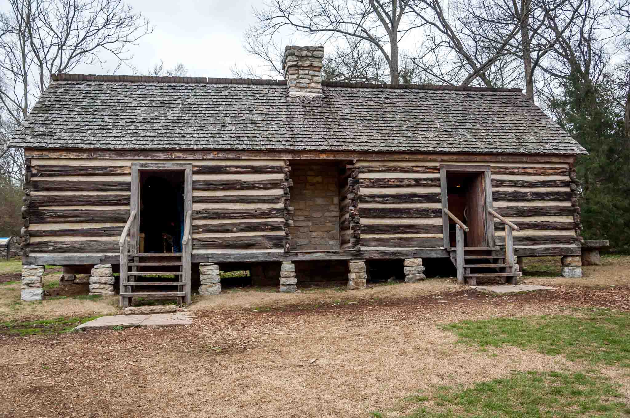 Log cabin with chimney, a reconstructed slave cabin on the grounds of Belle Meade