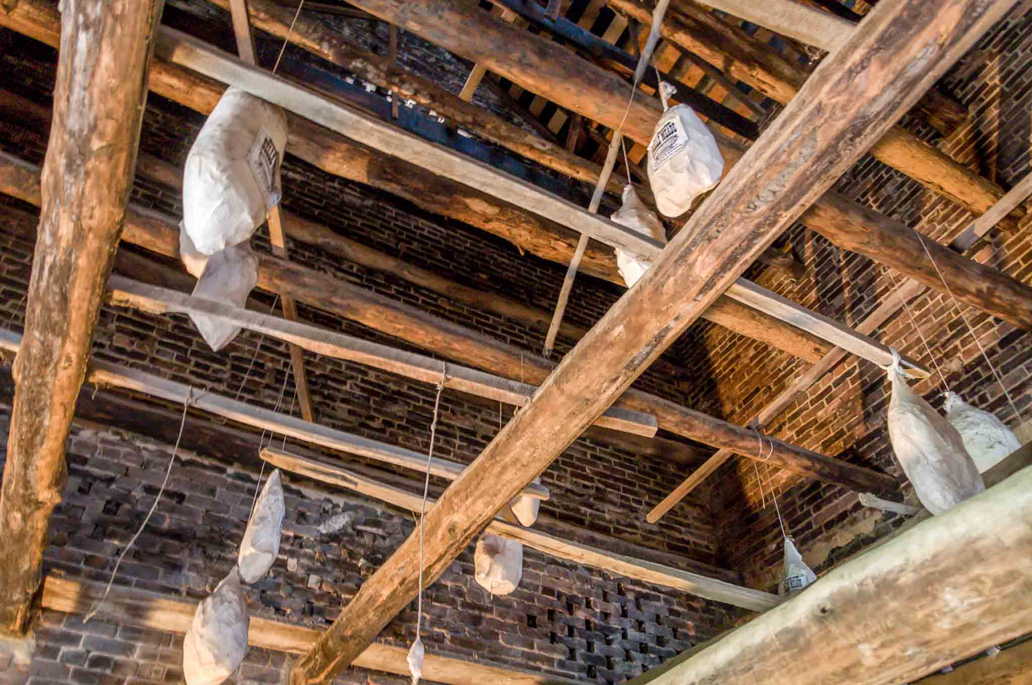 Pork curing in the smokehouse rafters