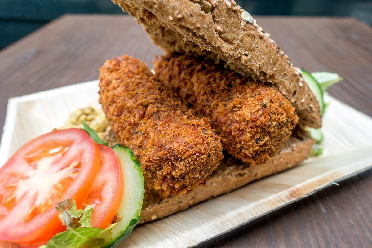 Croquettes on a roll with tomato