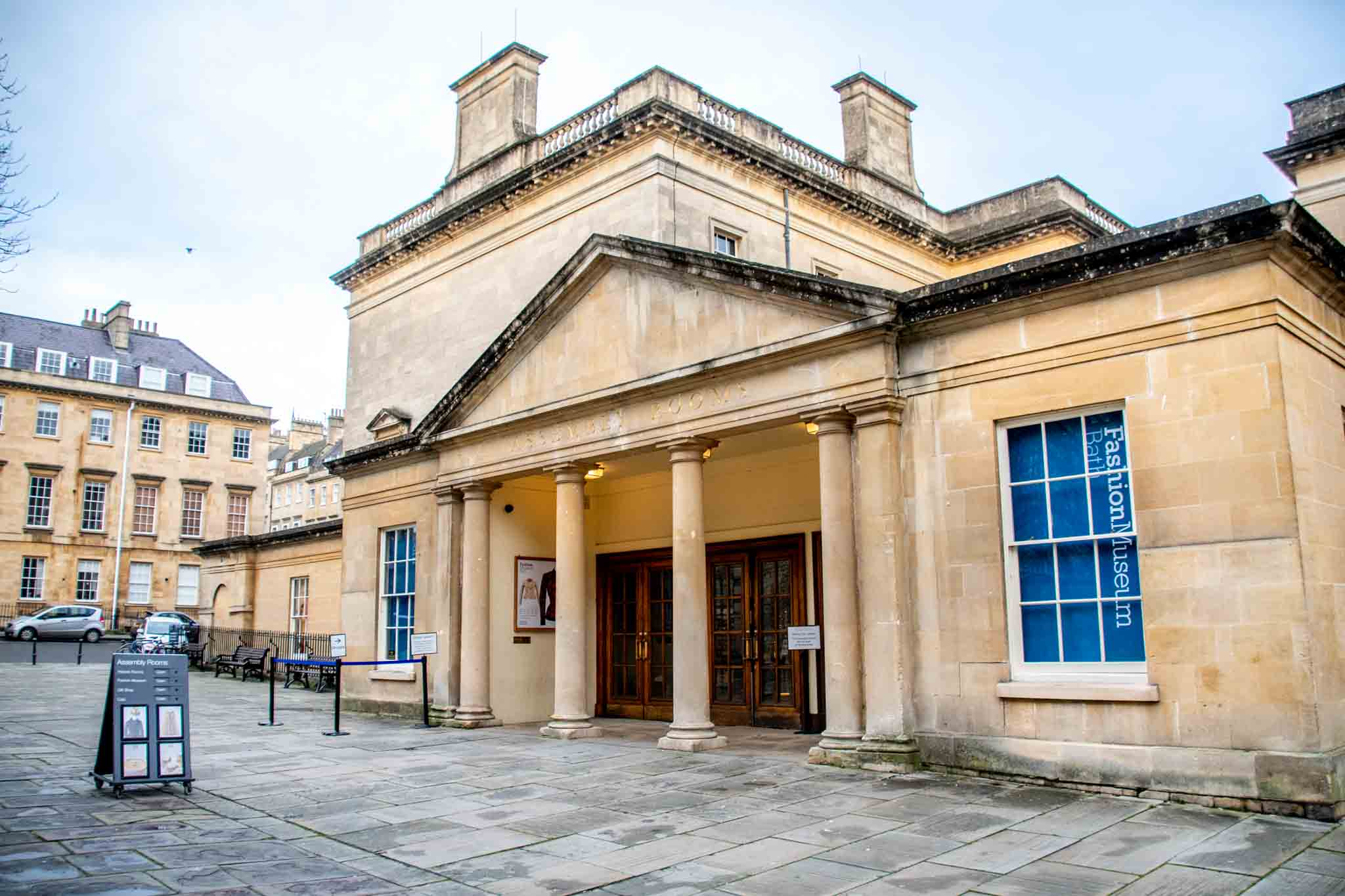 Yellow exterior of the Bath Assembly Rooms, the home of the Fashion Museum