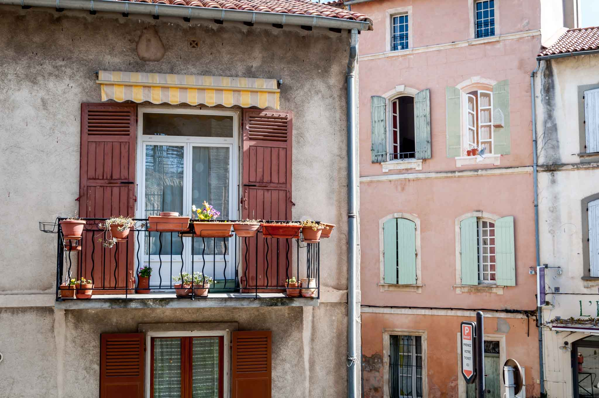 Colorful window shutters on a 10-day South of France itinerary