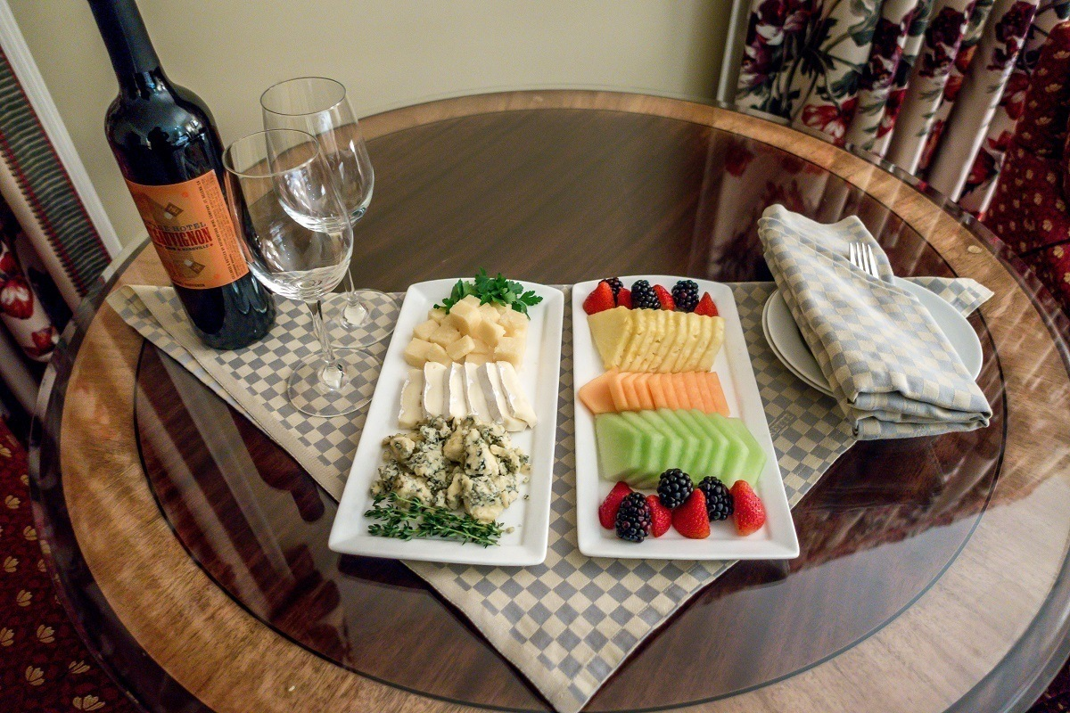 An in-room welcome gift of wine, cheese and fruit