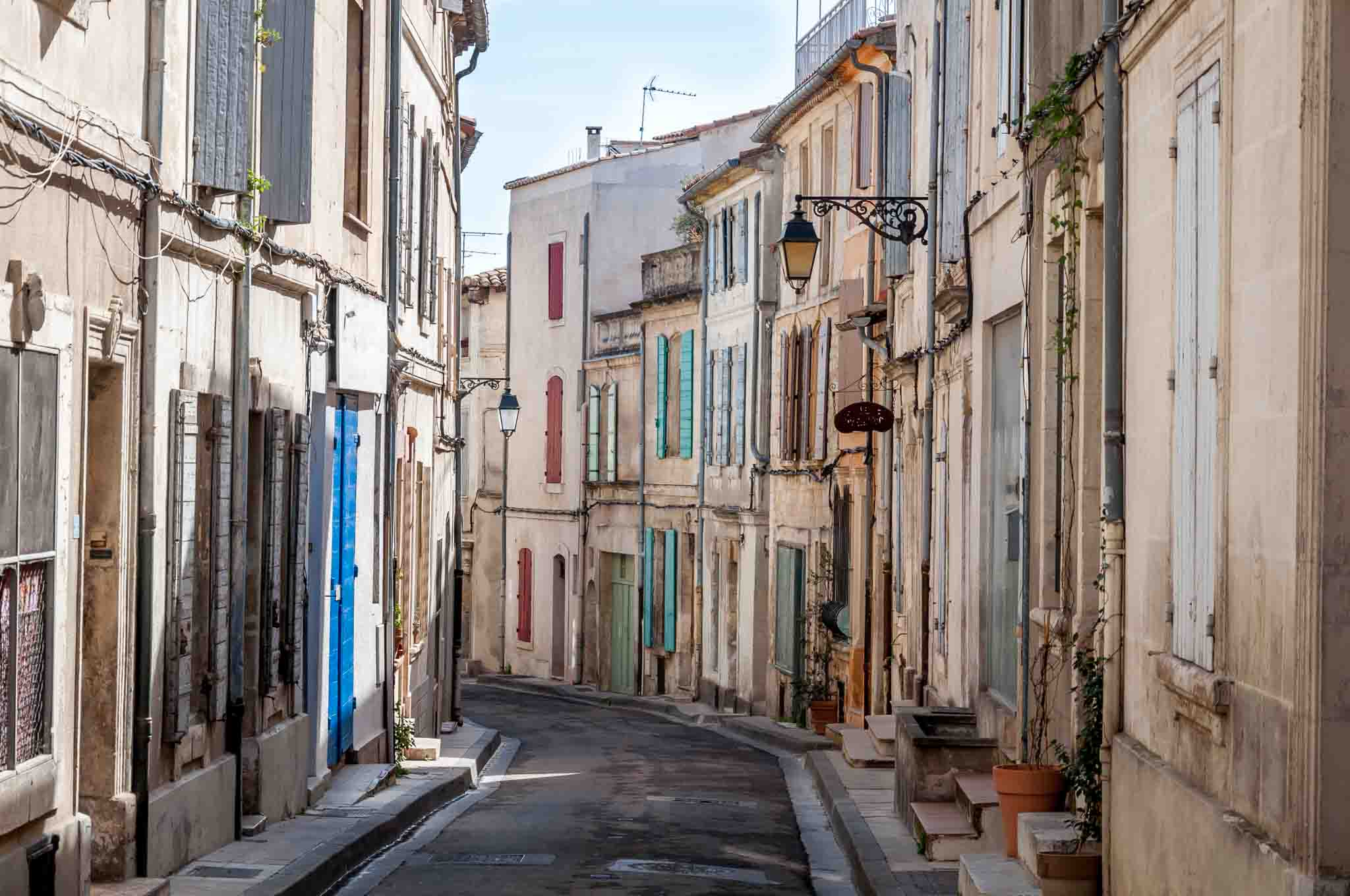 Street full of homes with colorful shutters