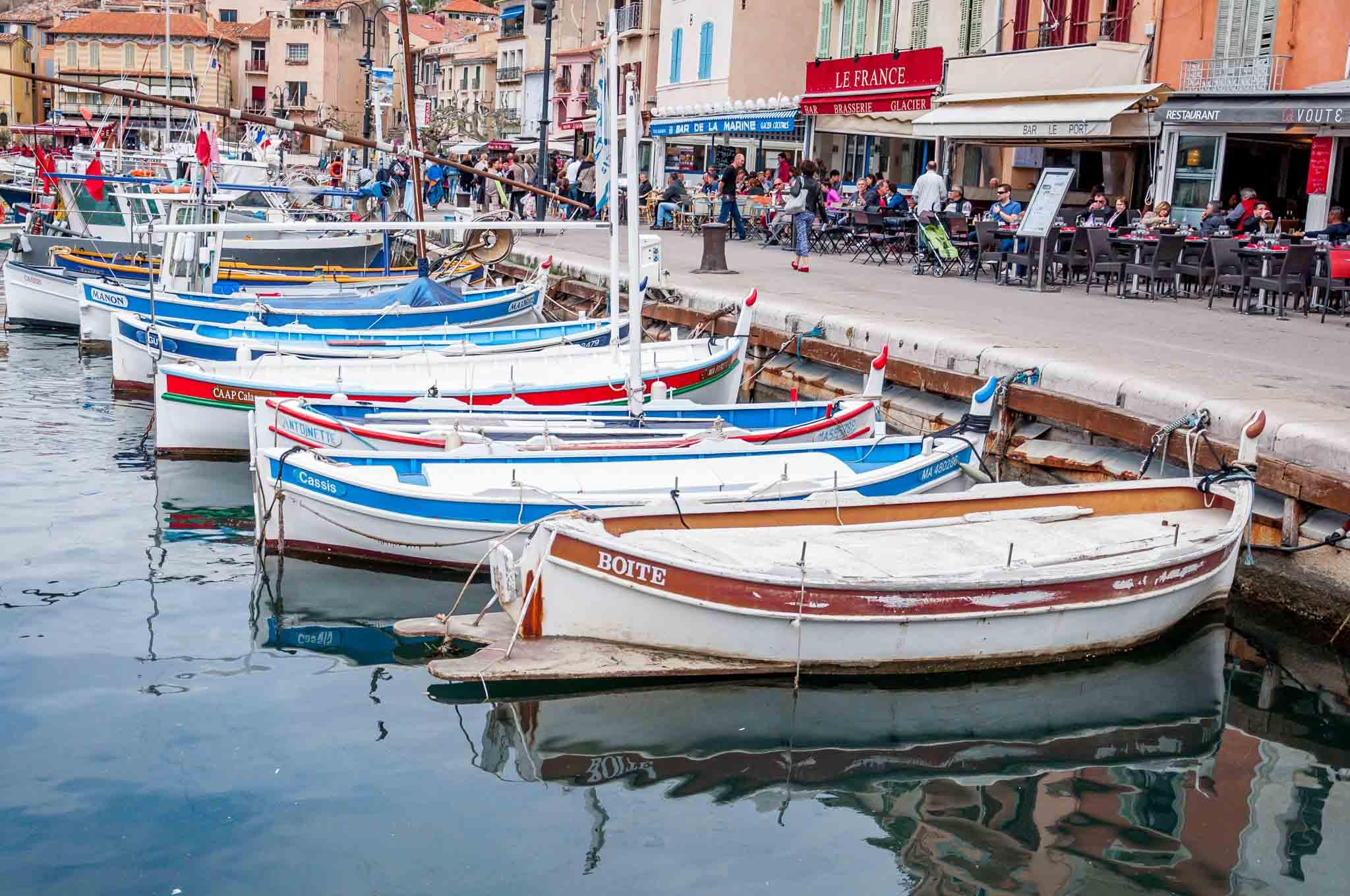 Boats docked beside a seaside restaurant