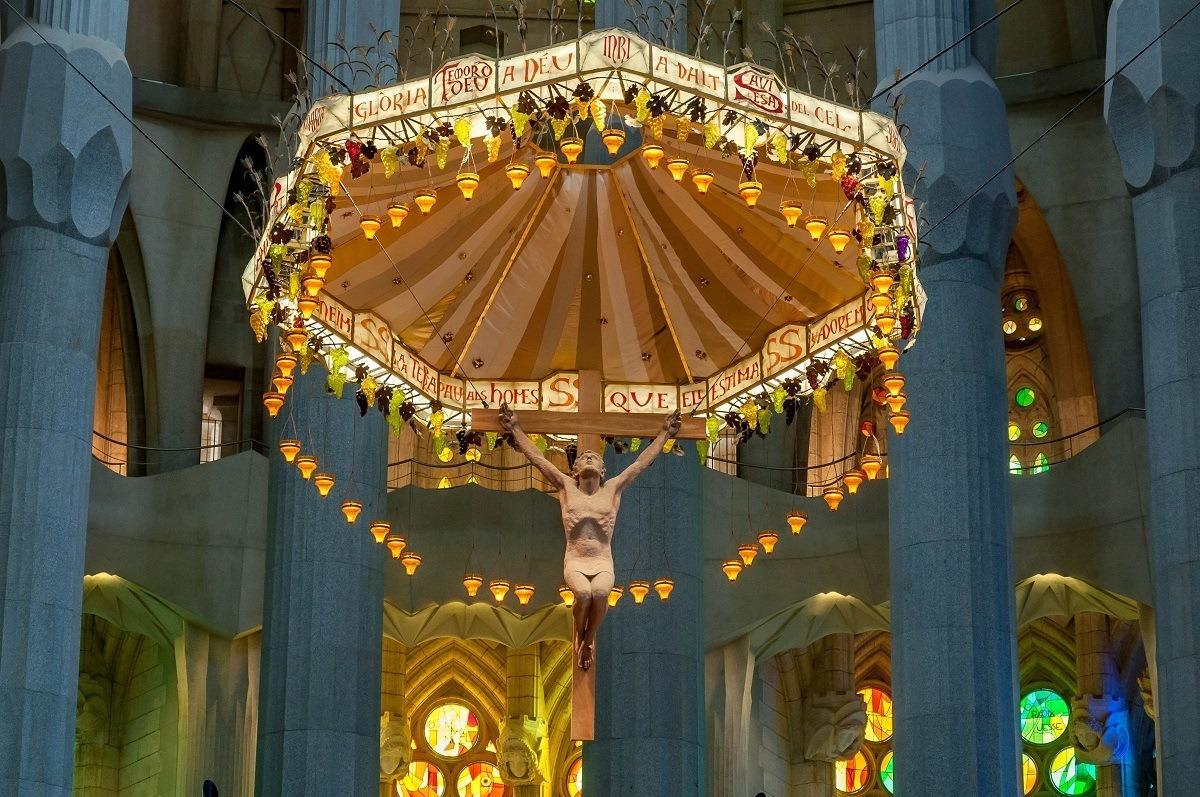Altar with Jesus on the cross inside Sagrada Familia in Barcelona