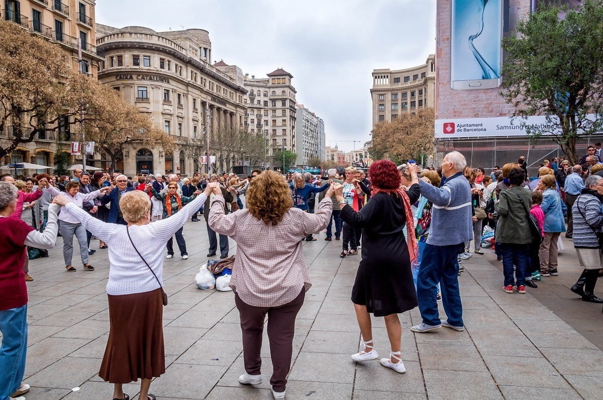 People dancing the Sardana in front of the Barcelona Cathedral in Spain