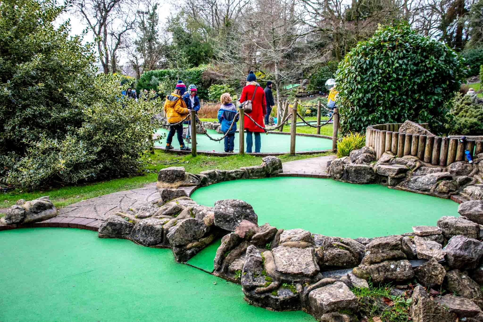 People playing mini golf