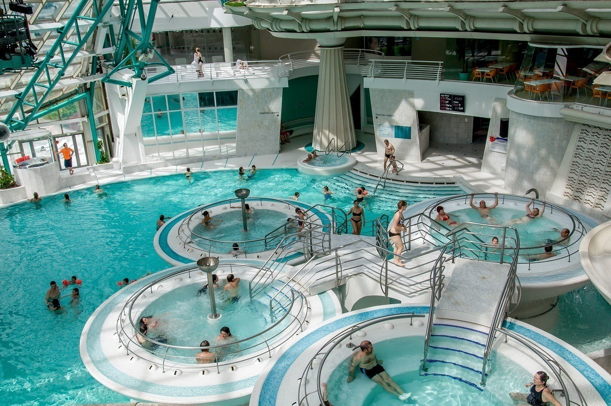 People in the pool pods at the Caldea spa in Andorra