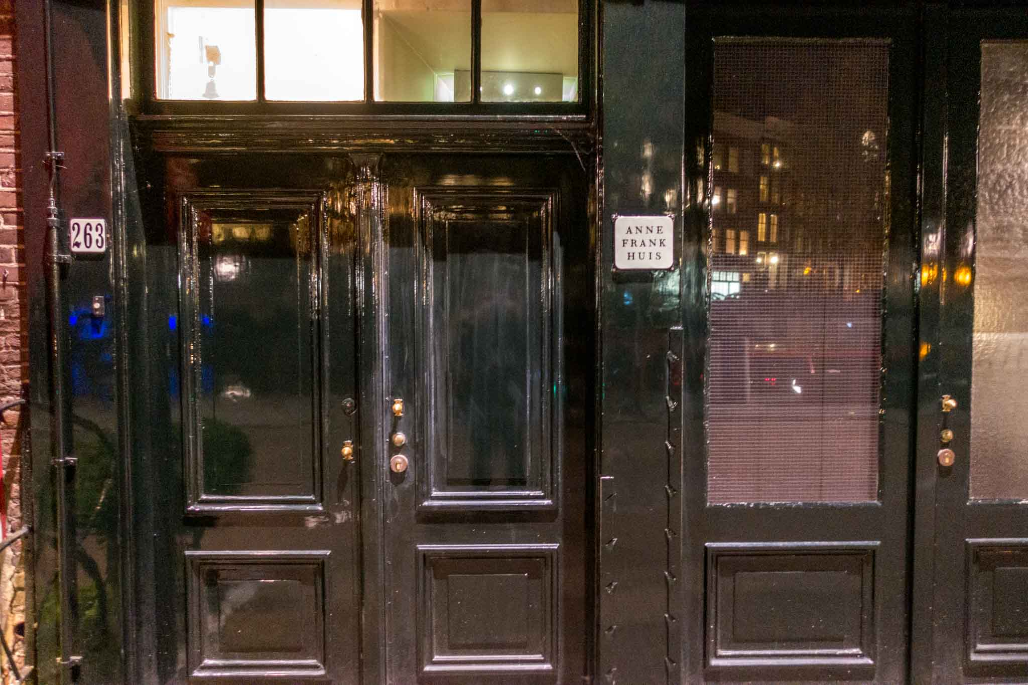 """Black doors with sign for """"Anne Frank Huis"""""""