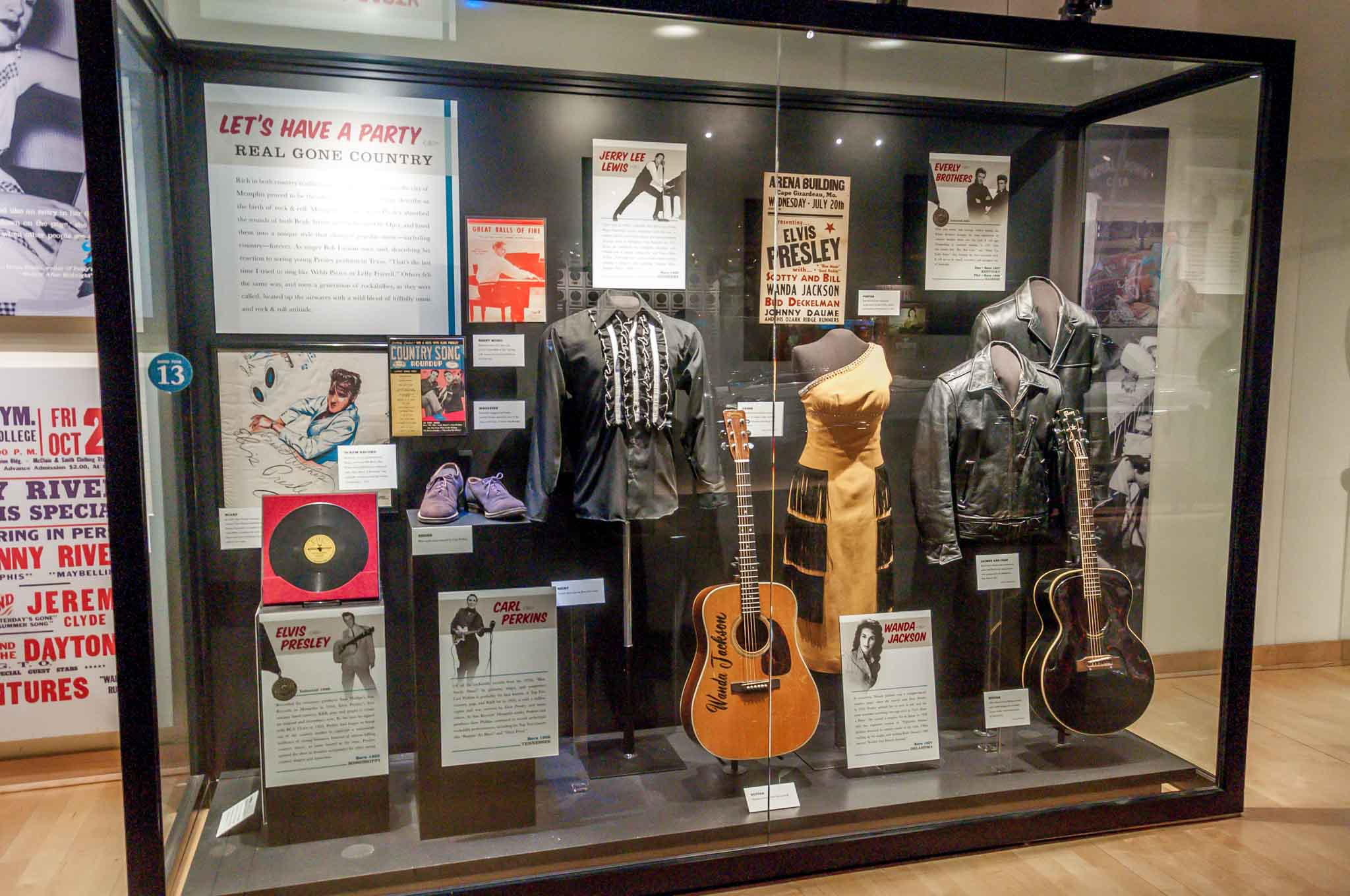 Museum display of records, guitars, and costumes