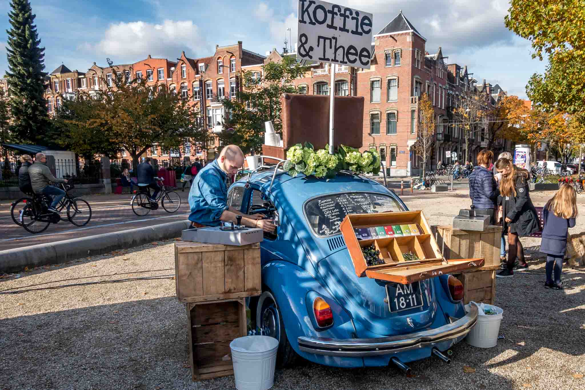 Man serving coffee from a VW bug