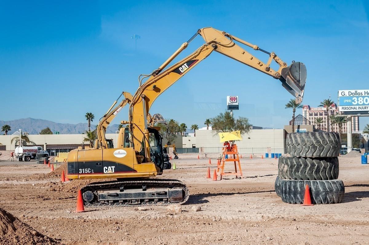 Excavator picking up tires