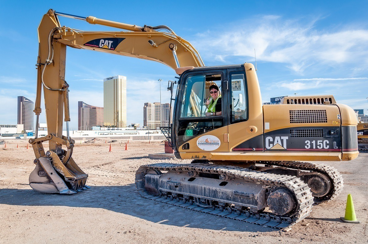 Lance driving an excavator in a diesel-fueled rush at Dig This in Las Vegas