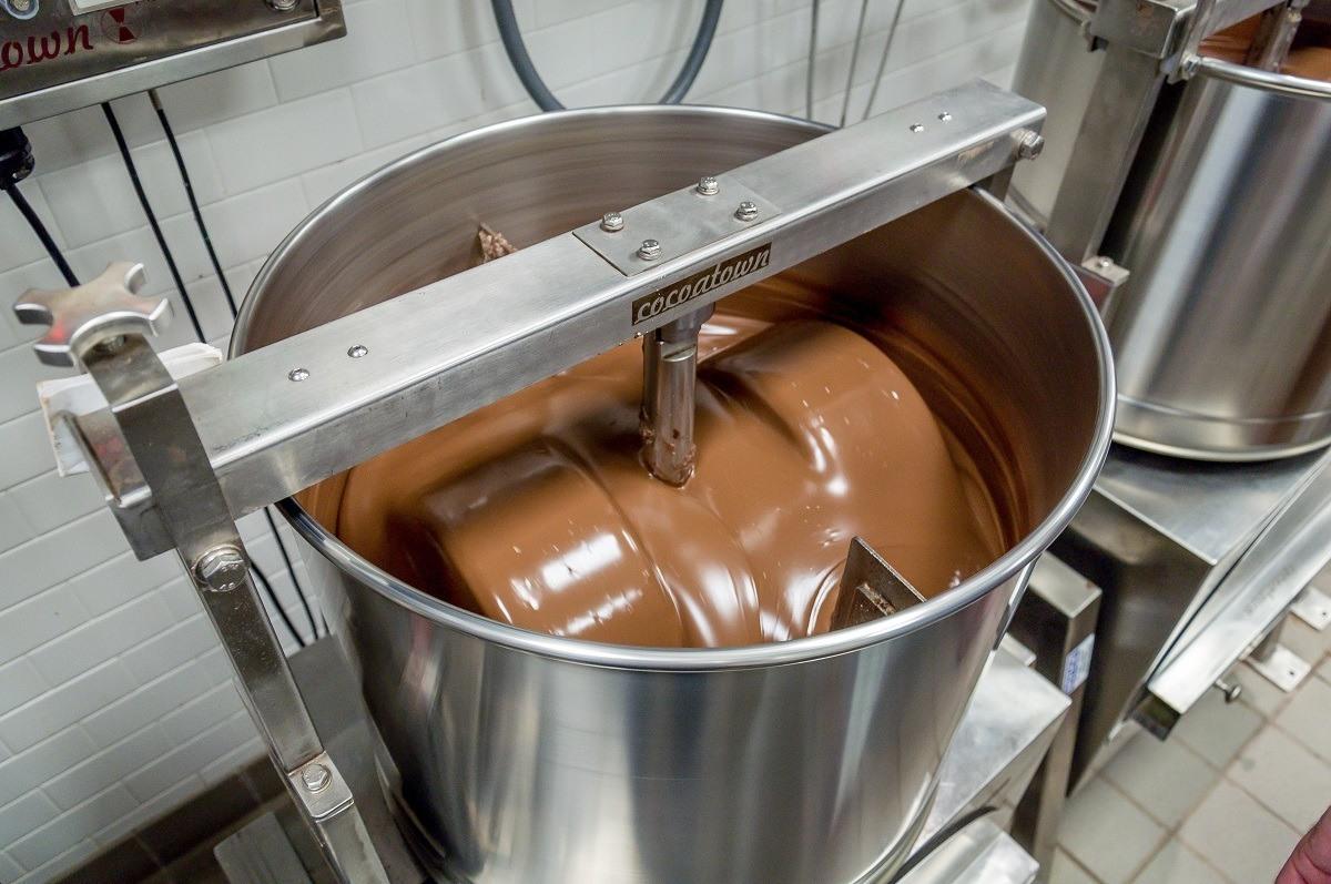 Chocolate mixing in giant steel vat at Hexx in Las Vegas