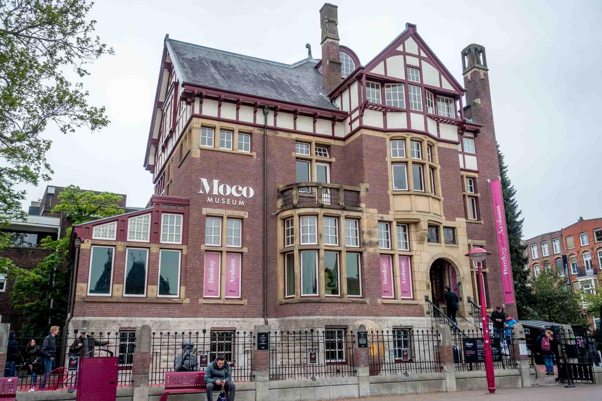 Large brick townhouse with purple trim: MOCO Museum