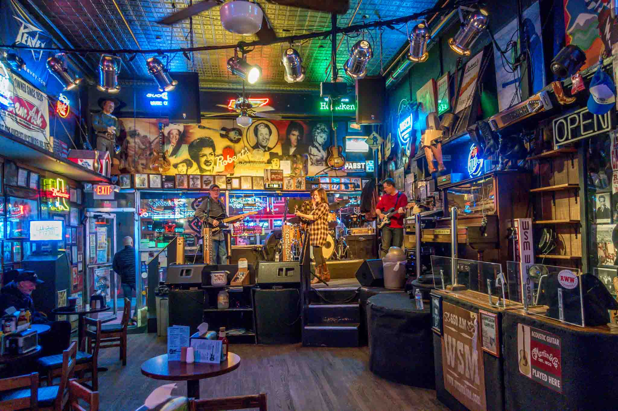 Band on stage at a memorabilia-filled honky tonk