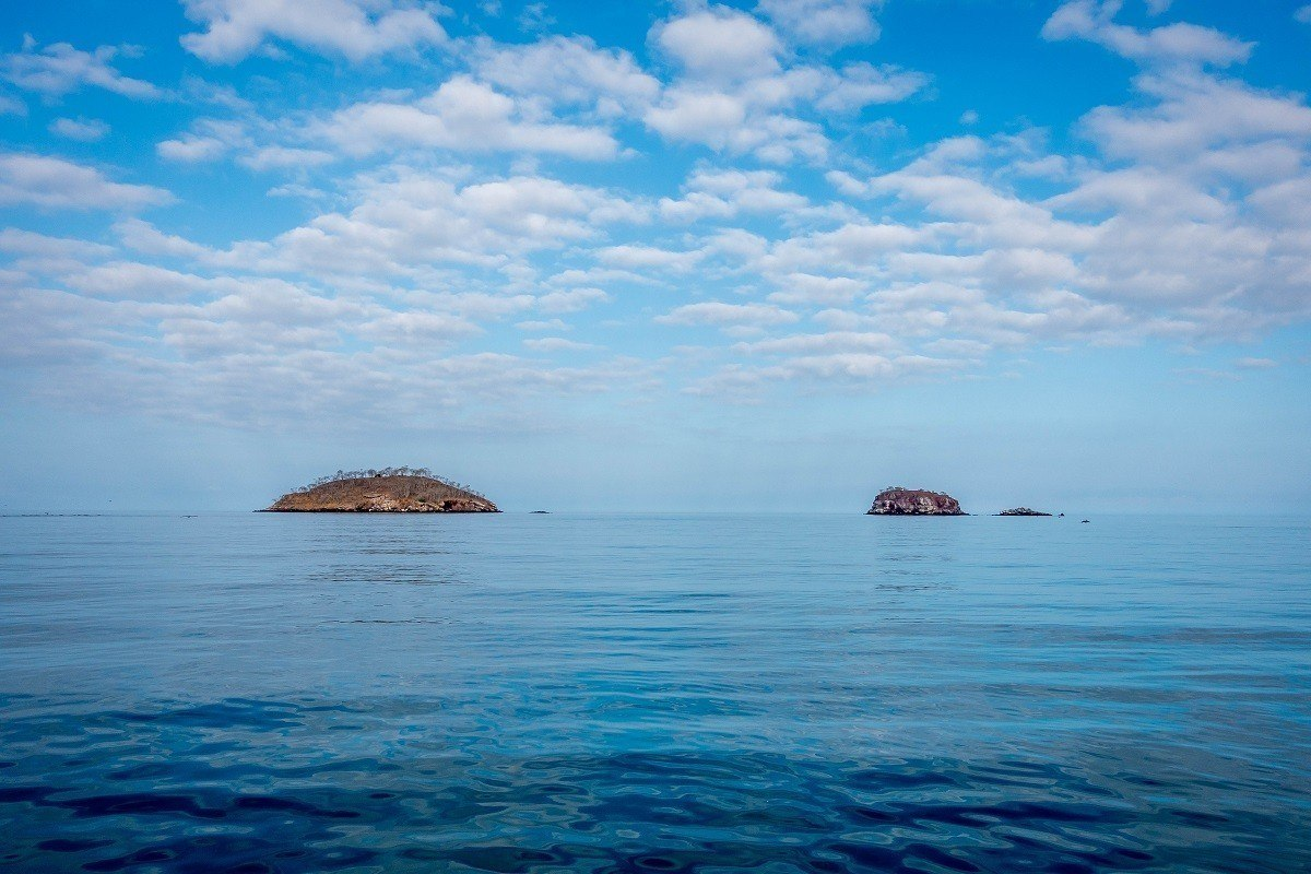 Tiny islands in the ocean off the coast of Isabela Island