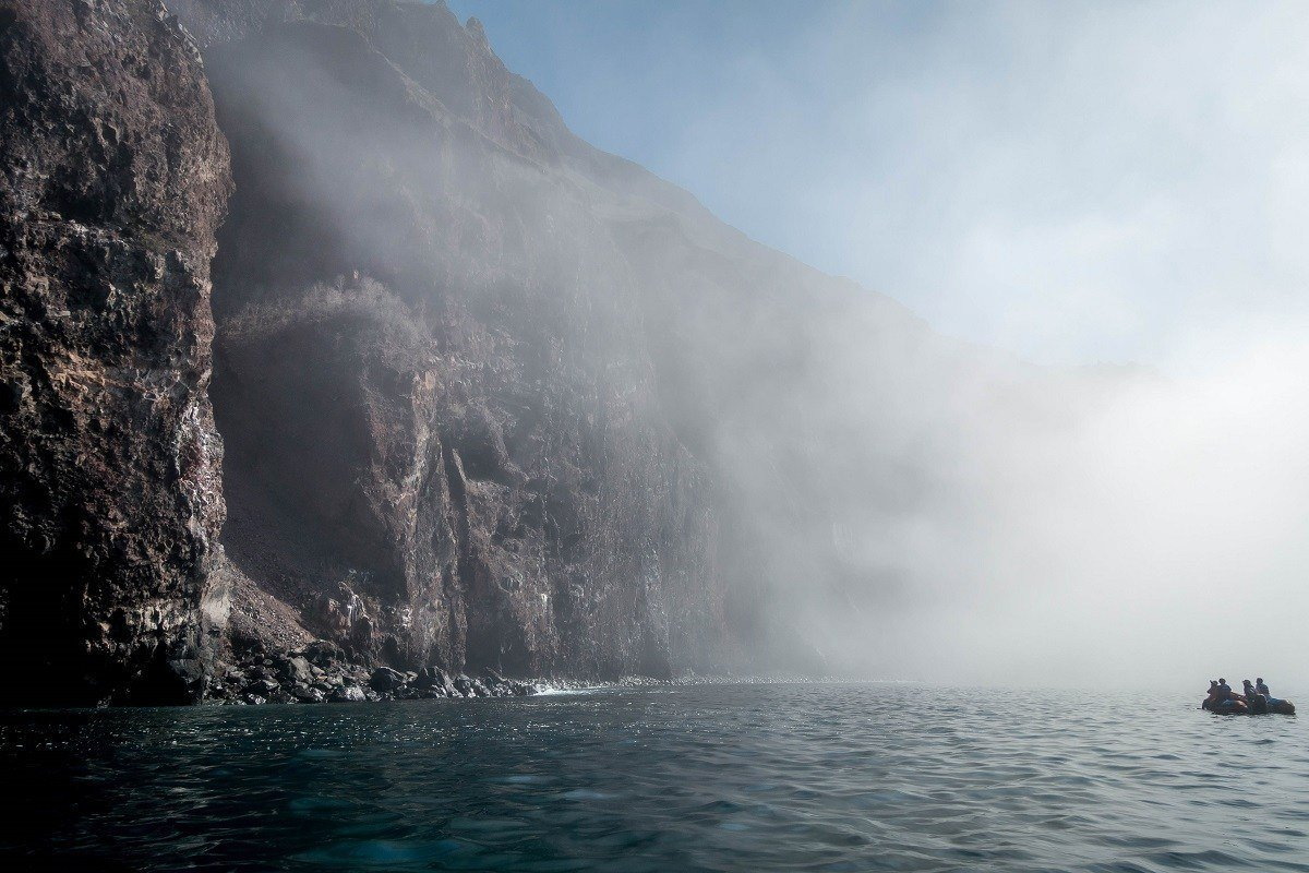 Dinghy and cliffs in the Galapagos Islands at Punta Vicente Roca
