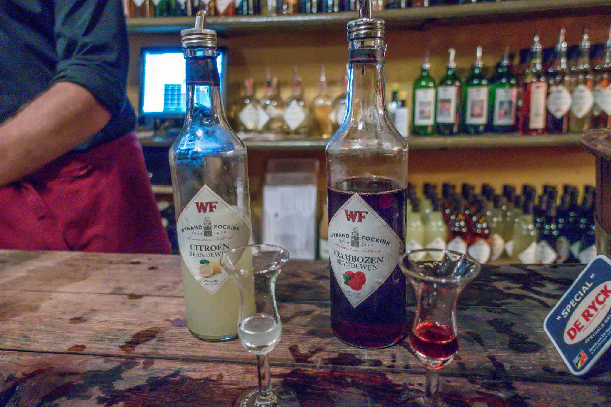 Bottles and glasses of fruit brandy on a bar