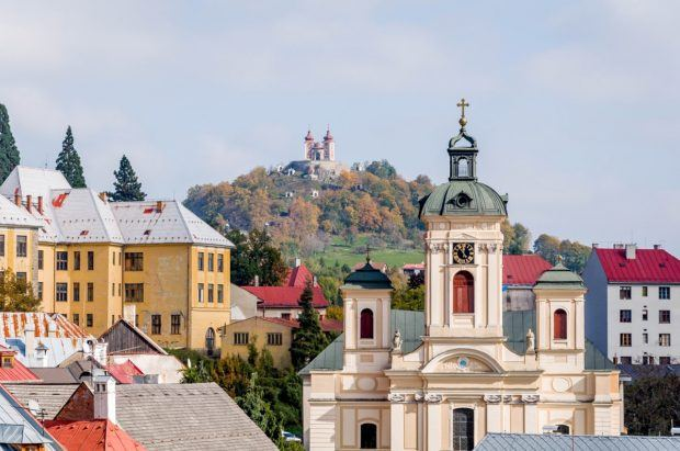 Buildings and a church at the base of a hill