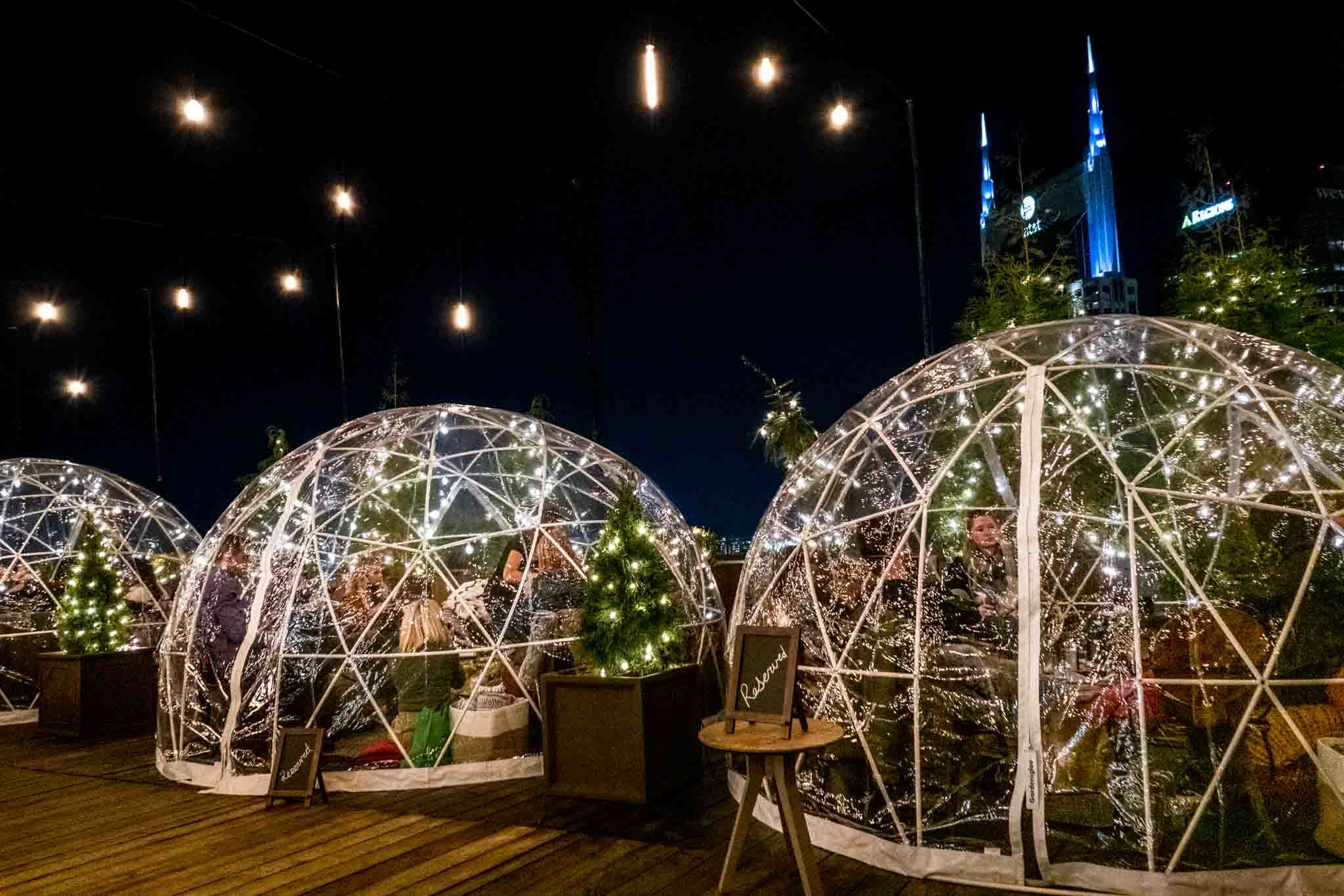 Igloo tents at night on the rooftop at Bobby Hotel