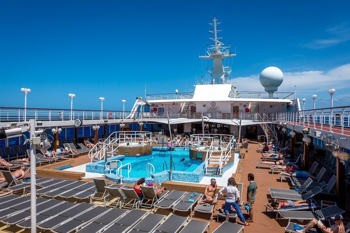 The Lido deck and pool on Fathom's Adonia cruise ship