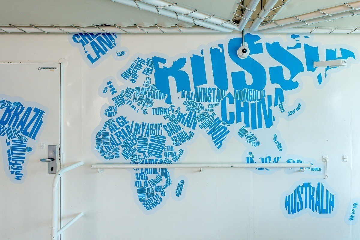 Map on a wall where words take the shape of countries
