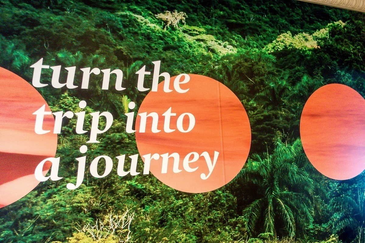 """""""turn the trip into a journey"""" -- a poster reminder on Adonia"""