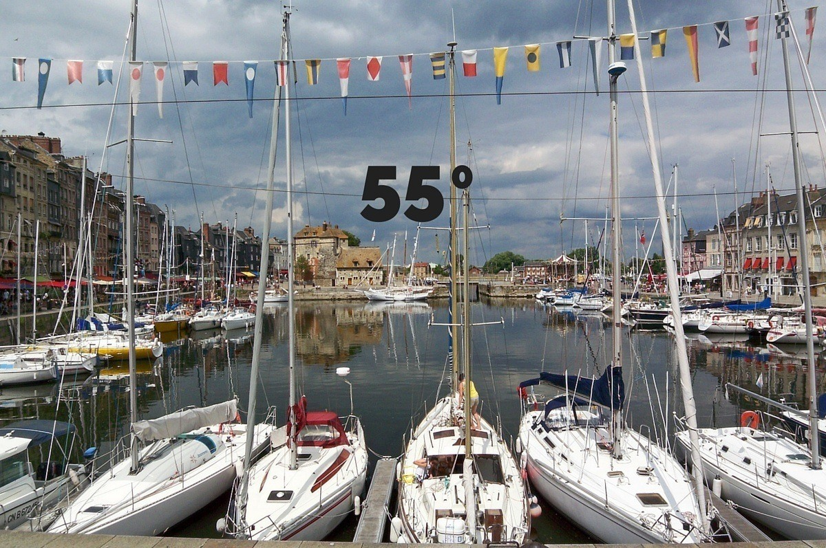 """""""55 degrees"""" superimposed over boats in a harbor"""