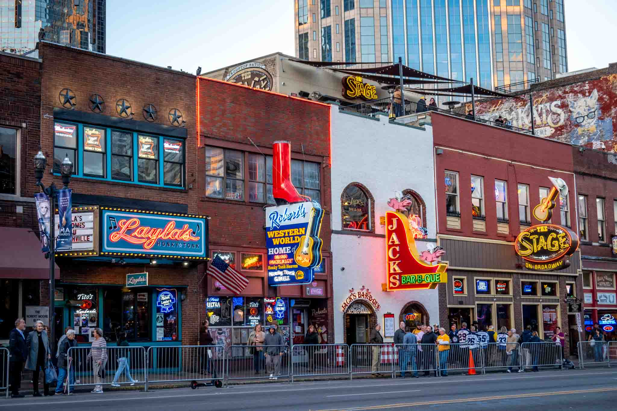 Exteriors and neon signs on a street of honky tonks and bars