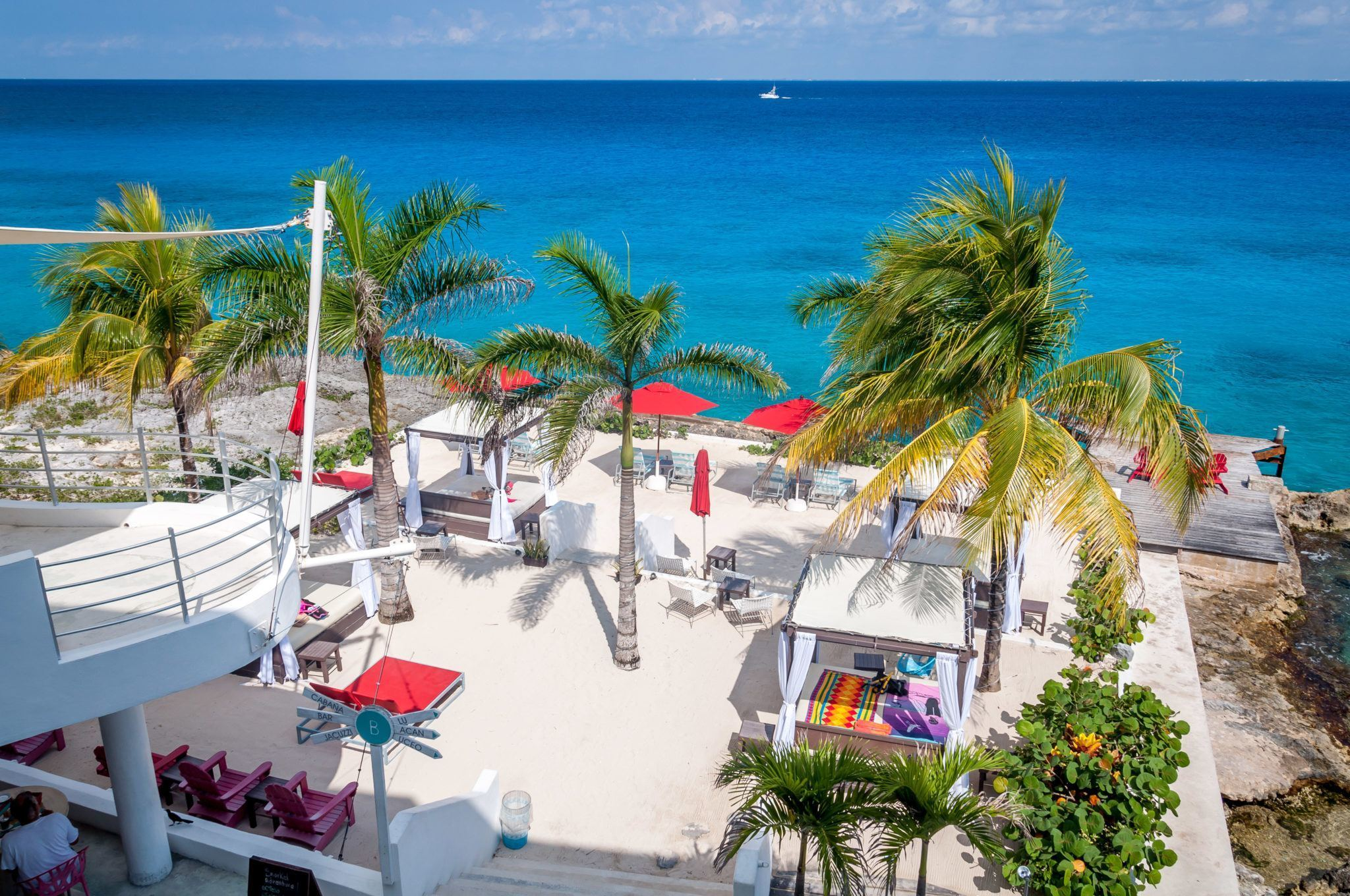 Palm trees and oceanfront views from the Hotel B Cozumel
