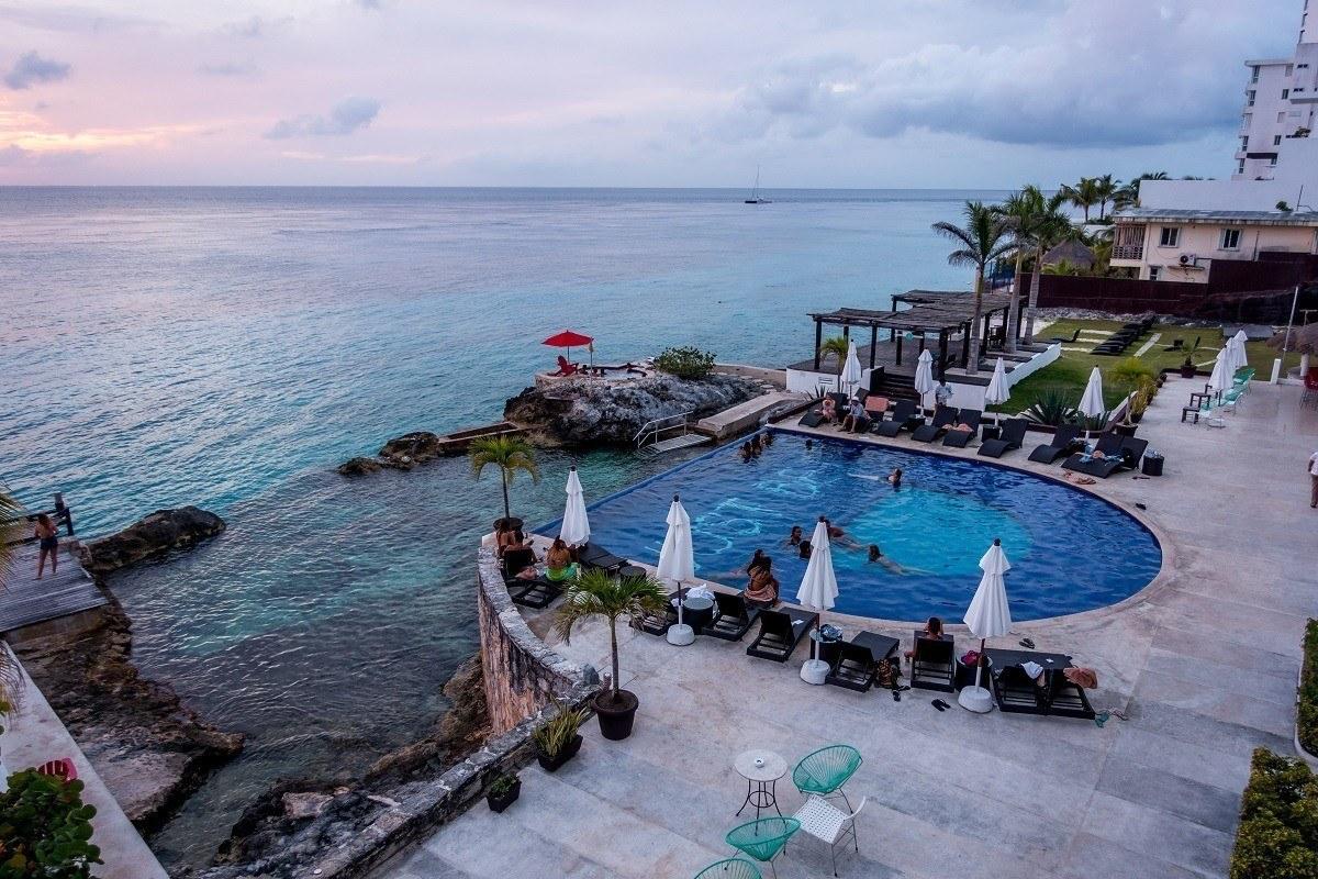 The Hotel B Cozumel pool at sunset